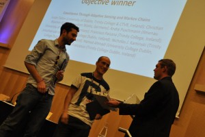 Justin and Francisco receiving the first prize, a USRP X310.